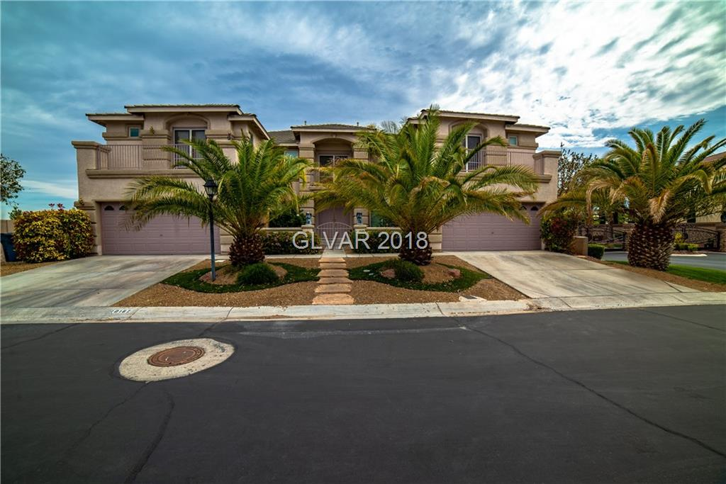ALMOST 1/2 ACRE LOT IN GATED COMMUNITY! WELL MAINTAINED LANDSCAPE. BUILT IN BARBEQUE AND GRILLING ISLAND. BALCONY.  ENTERTAINER'S DELIGHT. 2 LAUNDRY ROOMS. 4 CAR GARAGE. 5 BEDROOMS & A DEN. 5 BATHROOMS.