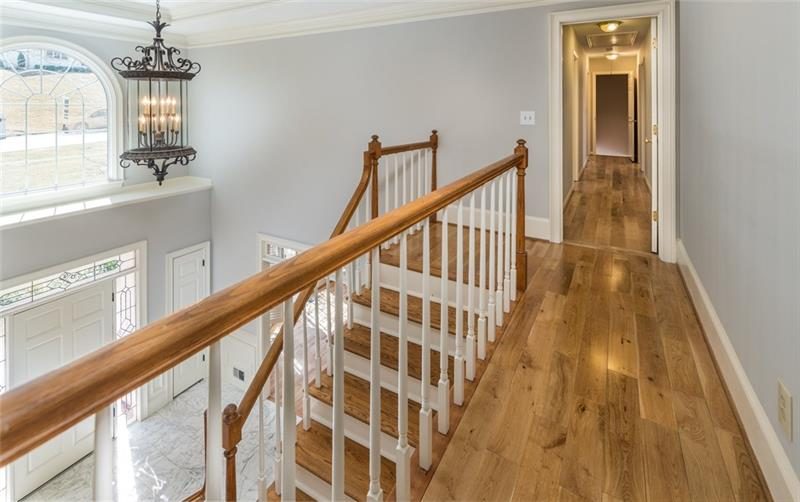 Truly stunning views of the foyer from the upstairs landing!