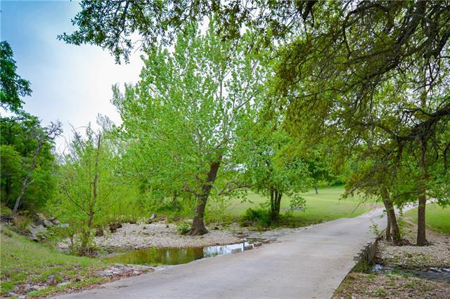 Incredible 96 acre hill country ranch! Minutes from Hill Country Galleria & LTISD! No restrictions, Lush pastures bordering nearly 3000 ft of a flowing, year round creek. Hill country views, cleared of cedar and hundreds of Oak trees! 3 cabins and historic barn sit below hillside under towering, mature oaks. Great access to Dripping Springs and Bee Cave!