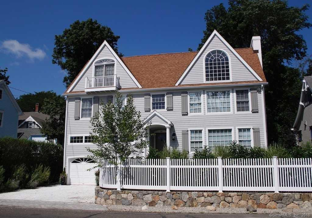 Like new with water views, this home offers stylish coastal living in Rowayton! Relax in the great room or family room with the ease of two gas fireplaces, or in the master suite with balcony doors opening to the best water views and summer breezes off the sound. Spacious kitchen with Viking and Subzero, granite counters. Freshly painted inside and out, you will love the easy care yard, back patio and outdoor shower after coming home from the beach. House equipped with generator, surround speakers, 2 car garage, 570 SF storage area, sprinkler system, outdoor gas fire pit. Property is perfectly located for a five minute walk to the beach, village, dog park, library, school, nature preserve and restaurants. All a 55 minute train ride to NYC. Perfect!