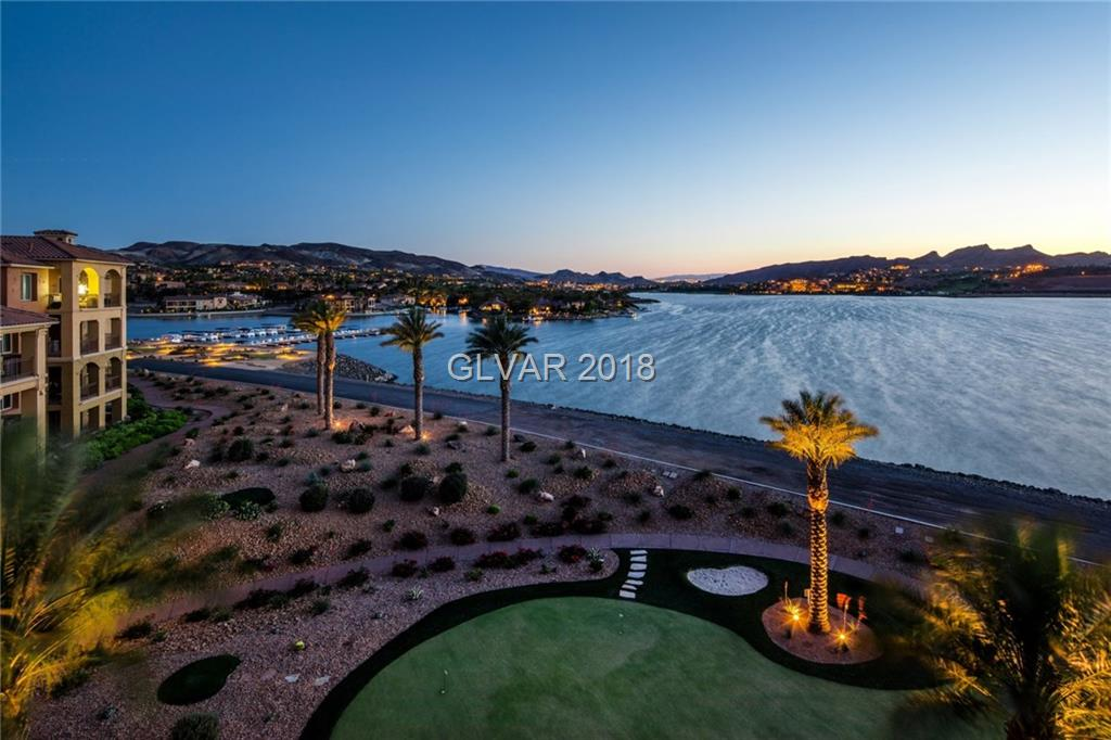 One of the best views in all Vegas! This penthouse condo offers panoramic water, village & mountain views with the finest perspective of Lake Las Vegas. 2 Master Suites; Owner's Choice! Custom upgrades throughout, full bar, grand kitchen, 2 covered balconies and front courtyard provide premium living. Located in guard gated community of SouthShore at Lake Las Vegas. Within mins of dining, grocery, golf, & Lake Mead; only 35 mins from the strip.