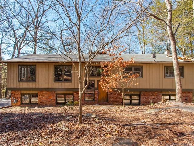Enjoy the beauty of nature in this updated home! This split-foyer home offers plenty of privacy on an almost three-quarter acre lot. The main living space is bright and open, with hardwoods throughout. The kitchen has been updated completely, including stainless steel appliances, and contains a spacious island for even more counter space. Bathrooms have been completely updated and have tile throughout and modern fixtures. Spend time in the family room that leads outside to the top level of an expansive two-story deck overlooking a natural setting with long-range winter views. The bottom level contains a full bathroom and is ready for you to come in and make your own!