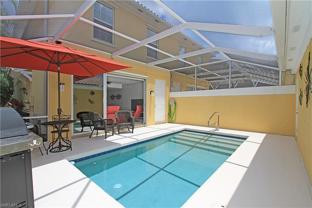 Substantially upgraded Cayman townhome in quiet location. Oversized lot gives extra space between you and the neighbors. This solid poured concrete home is BUILT SOLID by award-winning DIVOSTA HOMES. Pool has a screened patio and new Penta pool pump. Home lives large with two oversized bedrooms and bathrooms upstairs, one bedroom and bath downstairs. Large electric shade in great room operates at the touch of a button, and sliders feature window tinting. One year new variable cycle air conditioning system is top of the line and whisper quiet. High-end Stainless kitchen appliances are in new condition. Upgraded washer and dryer have high capacity. Porcelain tile and fresh neutral paint. This home is a short stroll to the Verona Walk Town Center, a 20,000 square foot mecca of recreation and entertainment opportunities. More than 20 miles of walking paths connected by Venetian bridges for biking, jogging or riding in your golf cart. Convenient to an array of shopping and restaurants in Naples & Marco Island. Verona Walk offers resort style living without additional club fees. A 24 hour manned gatehouse provides a convenient but secure entry for residents.