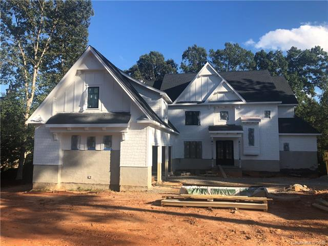 New construction on the 8th Fairway of Trump National Golf Course. Beautiful wooded lot with seasonal water views. European-style home with progressive, open floor plan. High quality finishes planned throughout. Granite, custom cabinetry and quality stainless steel in kitchen. Off-site septic means this residence can accommodate a pool if Buyer wishes to add. Unfinished basement with option to finish. Includes conveyance of Pier E, Slip 18. This is the only NEW home available on the golf course!