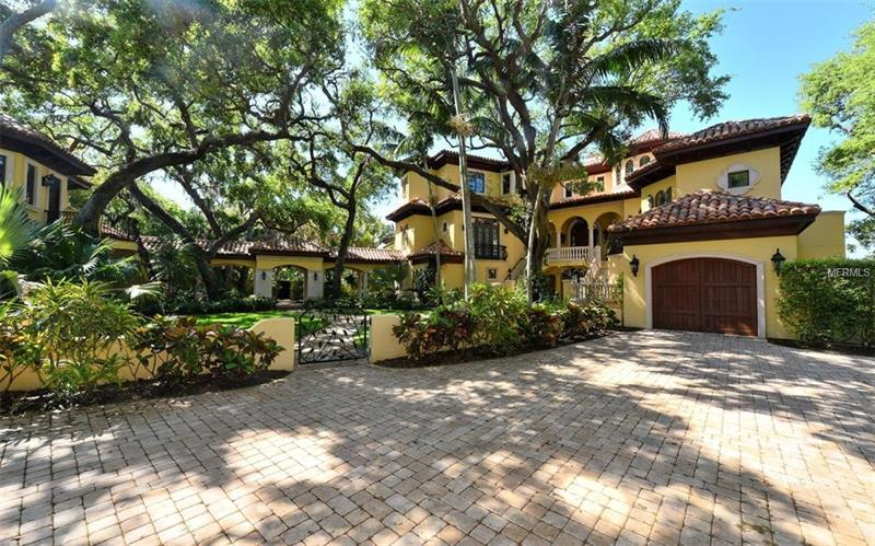 Casa de Familia, one of Sarasota's most beautiful bay front homes, is offered for purchase for the very first time.  This exquisite family residence is masterfully nestled among majestic grand oaks on a 1.6 acre walled and gated estate with 140 ft of prime shoreline.  A tribute to Mediterranean Revival architecture, this stunning home thoughtfully balances authentic design elements of scale, symmetry, and handcrafted finishes with the requirements of today's active family.  Large gathering spaces for effortless entertaining seamlessly blend with private suites for seclusion and relaxation.  Curved moldings, ornate stonework, trompe l'oeil painting techniques, intricate iron railings, and hand-hewn walnut floors have been skillfully adapted to create this modern day sanctuary.  Traditional custom features, a chef's kitchen and luxurious master suite are artfully intertwined with family and guest friendly amenities, en-suite bedrooms, bunk room and dazzling pool with waterfall and dive platform.  An extraordinary, elevated walkway spans the pool to a covered loggia perched above the water and grounds providing the perfect area for morning coffee and breathtaking sunsets.  A magnificent oak canopied courtyard, with clay-tiled portico, connects the main residence to a two story casita, the ultimate retreat for guests and extended family.  Casa de Familia offers a rare blend of old world craftsmanship and cherished privacy, moments away from Sarasota's downtown arts district and international airport.