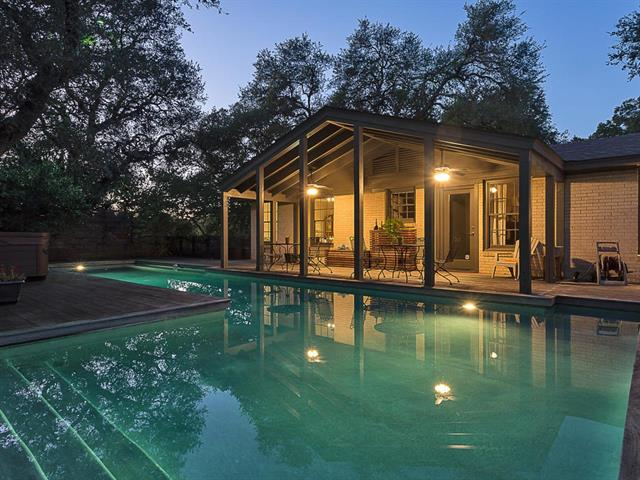 This central Austin mid-century home on over ½ acre offers privacy, a spacious and park-like backyard, gorgeous pool area, 3 spacious bedrooms + 2 bathrooms and large laundry / utility room with lots of storage.  Master suite w/ vaulted ceilings completed in 2002.  50' lap pool w/ ipe deck added in 2008.  Enjoy picturesque evenings with sunset shining through the trees and illuminating the back yard in golden light.  Privacy fences on three sides offer seclusion and a sense of solitude.