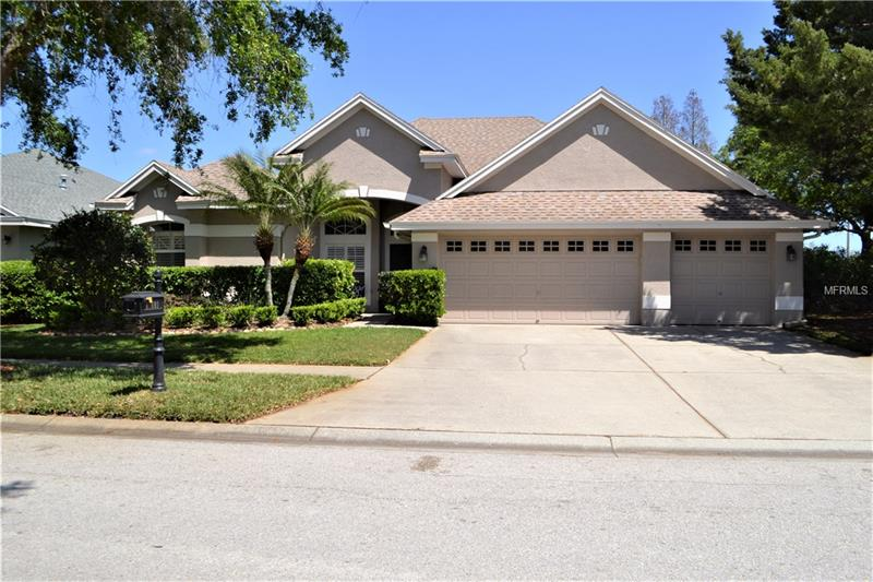 Meticulously maintained executive home in the highly desirable Fords of Westchase! Located on a large lot with spectacular pond views, this open floor plan home has four bedrooms, four bathrooms, office/den, and upstairs bonus room. This home has been completely renovated including new wide plank wood floors, upgraded 5-inch baseboards, and crown molding throughout downstairs living areas.  The gourmet kitchen is a chef's dream with 42-inch cabinets, quartz countertops, marble backsplash, soft close drawers and a huge walk-in pantry. The extended saltwater pool lanai boasts amazing pond views as well as brick pavers, built-in grill and cedar plank ceiling. A perfect area for entertaining! The master suite features his and hers closets, remodeled bath with custom vanities, garden tub, frameless glass shower and granite countertops. The upstairs bonus room has more breathtaking pond views, as well as a full bath and two large walk-in closets.  A truly flexible space that can be used in so many ways! Other features include plantation shutters throughout, custom window treatments, upgraded light fixtures, lush landscaping, and large three car garage.  New A/C in 2017. An amazing home ready for you to move in and make it yours!    *Green egg, washer/dryer and kids room curtains do not convey.     *Green egg, washer/dryer and some bedroom curtains do not convey.