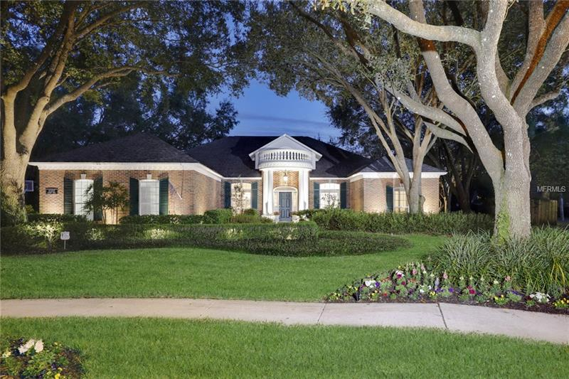 Straight from the pages of Southern Living! This signature property is nestled under the canopy of stately oaks on a quiet cul-de-sac in one of the most desirable neighborhoods in Tampa Palms. The grounds offer a park like setting measuring almost 2/3 of an acre. The home has been completely remodeled over the years with only the finest materials. It boasts 4 bedrooms, 3 baths, office and side load 3 car garage. An inviting curb appeal with manicured gardens, brick finish, custom gable fascia and formal column entry makes this signature property a rare find indeed. You'll be impressed by the grand feel of the formal area. It has an elegant feel with wood floors, custom wood molding, plantation shutters and classic French doors. The airy kitchen is highlighted by rich finishes that include a Franke sink, Danze faucet, KitchenAid oven, refrigerator & dishwasher with Thermador range/hood, Sharp microwave, updated paneled cabinetry, lavish granite counters and a high top island with detail wood moldings. It overlooks the stately family room complete with brick fireplace and unbelievable views of the rear yard. The master retreat features a remodeled bathroom with Travertine throughout, steam shower, thick granite, upgraded mirrors and faucets. The large brick pavered lanai is perfect for large parties and overlooks one of the largest, most beautiful rear yards on the market today. Other renovations include new interior paint, renovated secondary baths with granite, built-in closets and more!