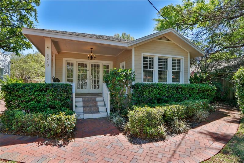 Bungalow Beauty! Built in 1930s, this tastefully restored 3BR/2BA bungalow located in Palma Ceia Park features the distinguished characteristics & nostalgia of yester-years, but offers the amenities of contemporary living to include a lagoon style pool with a cascading waterfall and a tropical backyard oasis. Original pine wood flooring & molding reflect the workmanship of the 1920s as seen upon entering through double French doors from the rocking chair front porch. Enjoy a glass of wine by your wood burning fireplace after showing off your culinary skills in your gourmet style kitchen or cap off the evening with a relaxing moonlit dip in the lagoon style Pool.  Kitchen features granite counters w/tumbled stone backsplash, 42-inch European style cabinetry, upgraded stainless appliances and recessed lighting. Your Master bath showcases a spa tub surrounded by a sea of granite adjacent to a glass enclosed shower & Tuscan style travertine flooring & Walk-In Closet with built-in organizers. Enjoy the light & bright feel with lots of windows, multiple French door sets & a skylight. Lagoon Style pool w/cascading waterfall surrounded by lush landscaping & a 2 tier deck is perfect for relaxing after a long day & entertaining.  2 Outside storage areas is ample for all your holiday decorations & bikes. Recent HVAC, Hot water tank, pool pump, exterior paint job, landscaping box, fans, + more… Sidewalks align the historic brick laid street & just a few minute walk to Datz and S. MacDill boutiques. Plant HS district.
