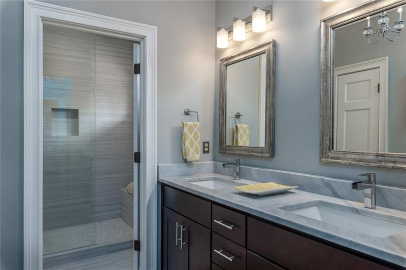 Beautiful master bath with huge walk-in, frameless shower with bench seat!