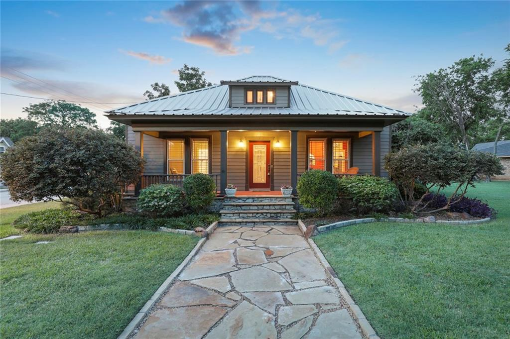 Must see home in Historic Downtown Frisco. Original restored hw floors lead from the entry through the family rm and into the updated kitchen. Jenn-Air gas range, ss appls, granite, shiplap walls & ceiling create a modern cozy kitchen. Bkfast nook, powder bath, utility room & mud room round out this great floor plan. The master bedroom w shiplap and master bath w black & white tile, granite and deep jetted tub are also down. Up is a second bdrm w small living area and full bath. The unique backyard features covered & uncovered patios, built in grill, and a guest house office – or even Air BNB. Single car garage w storage loft & covered parking for 6 cars. Upgraded insulation and windows w plantation shutters.