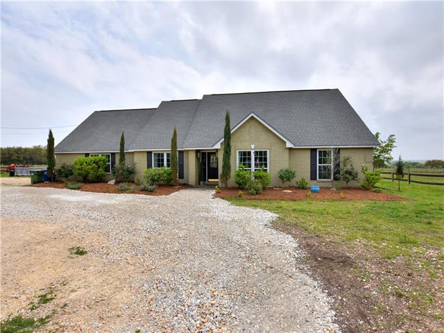 Beautiful custom home on over 5 acres in the highly sought after Sundance Ranch!  Horse lovers paradise with 6 stall barn, fencing, and cross fencing.  The home features an open floor plan with granite countertops, stainless steel appliances, wood floors, romantic double sided fireplace, 4 sides masonry, and large covered back porch perfect for entertaining.  The office can be a 4th bedroom & the bonus room upstairs is perfect for a game or media room.  Kids attend the acclaimed Liberty Hill schools.