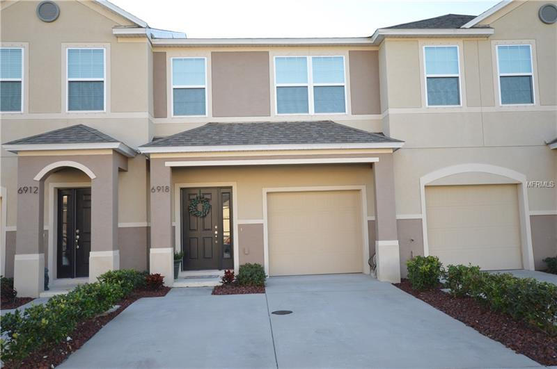PRICE JUST REDUCED!!! OWNER IS HIGHLY MOTIVATED TO SELL.  MAKE AN OFFER. Fantastic townhouse for sale at Village at Park Place neighborhood.  Built in 2015, this home has been beautifully maintained and features 3 bedrooms and 2.5 baths.  The great room on the first floor features an open floor plan highlighted by crown molding and hanging island light fixtures.  The kitchen features granite countertops, a center island, stainless steel sink, stainless steel Whirlpool appliances, and gorgeous all wood cabinets highlighted by a built-in wine rack you are sure to love.  The first floor also features dining room space and a half bath.  The second floor houses all three bedrooms, 2 baths, and a spacious inside utility room with a washer and dryer.  The master bedroom features a master bath with a shower, double sink vanity, and walk-in closet with plenty of space.  The location of this community is outstanding as it is within a short walk to The Shoppes at Park Place which includes many restaurants, a movie theater, clothing stores, a Starbucks and much more.   Conveniently close to US19 and I275.