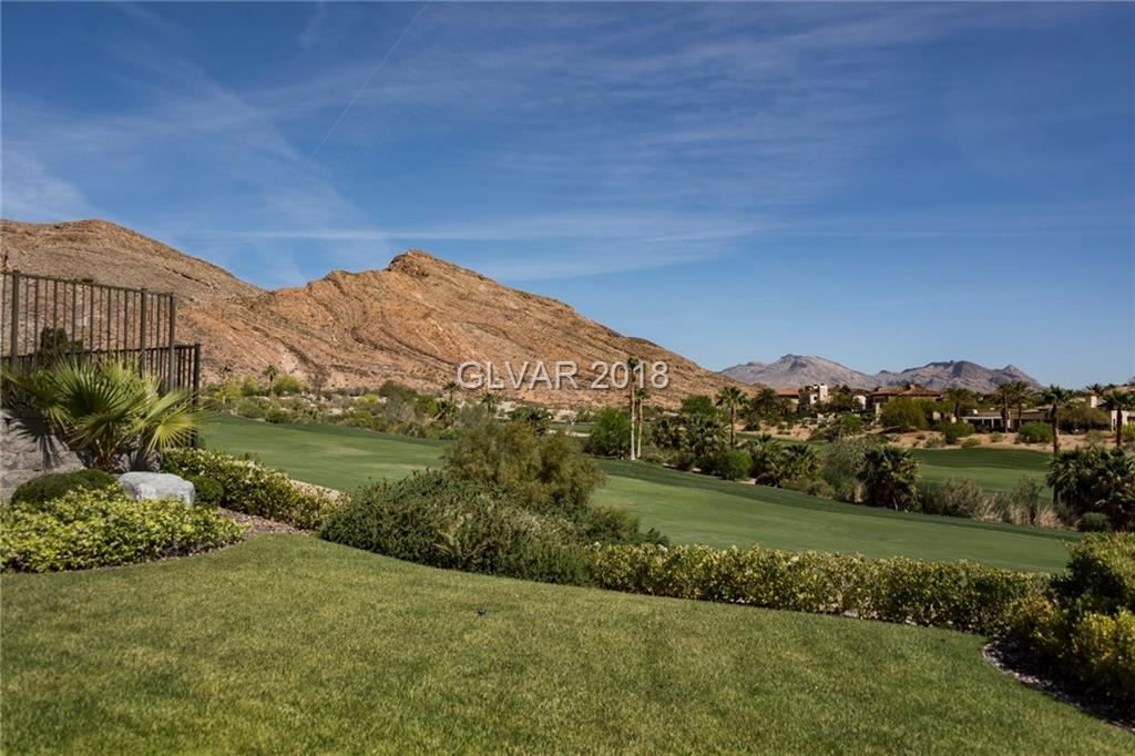 Elevated 1 story on 5th hole of private Mountain course w/golf & mountain views in Red Rock Country Club. Multiple exits to outdoors. Expansive living room w/14' ceilings & wet bar. Kitchen w/granite counters, wood cabinets, Jenn-air 5-burner stove, GE appliances. Master w/backyard access large hers & his closets, double granite vanities w/makeup counter, Kohler jetted tub. 2 en suite bedrooms & 1 casita, all w/access to central courtyard.