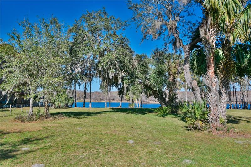 Bring your boat to this river front lot with 65' on the Saint Johns River. Build your dock and bring your boat to traverse to Lake Harney and Lake Monroe. Bring your fishing rod and enjoy the day bass fishing. Incredible vistas await as nature abounds including eagles, blue heron and hawks. There are 4 parcels being sold including the house/lot next door, a 2 acre lot directly behind and a .5 acre lot with a barn. Additional MLS id's are o5556889,oo5556882, o5556591. Call agent for more details.