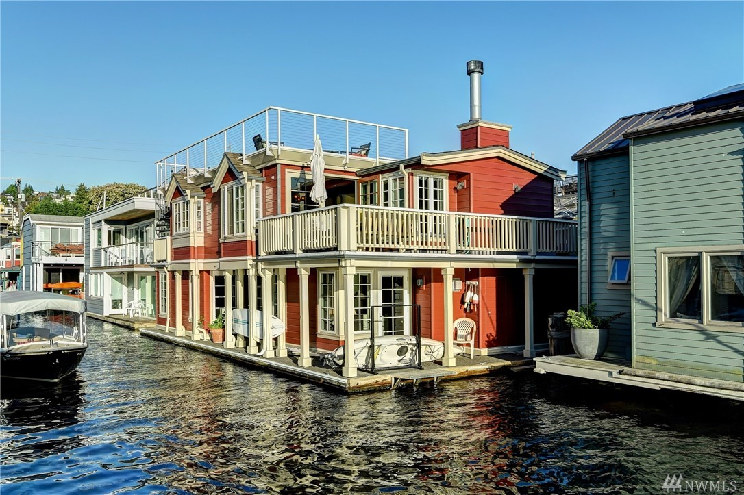 This 1,948 sq.ft. floating home is custom built for the quintessential Lake Union lifestyle. The upper level great room features reclaimed solid hardwoods, fireplace & deck for al fresco dining. A Chef's kitchen with island, farm sink and gas stove top makes for easy entertaining. 2 bed/2 bath down with a remodeled laundry room. The master suite faces Lake Union, a five-piece ensuite bath w/ soaking tub, and a walk-in closet; rare features on a floating home. Rooftop deck with 360 degree views.