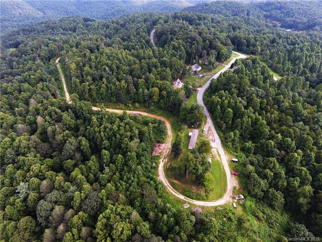 Looking for your own private paradise or looking for a development opportunity??  You don't want to miss this one!!  10.55 beautiful acres located in highly desirable Flat Rock area, property is located close to I-26 and Hwy 25 making a commute to Greenville or Asheville very easy. Very nice, like new 2014 3br/2ba manufactured home (16x70) that would make a perfect vacation rental or live in while you build your dream home. Possibility to build 6 or more homes on the property according to Henderson County, buyer to verify. City water on property, underground electrical already in place across property. Possibility exist to rejoin the Summit Springs development if buyer/developer wanted to.