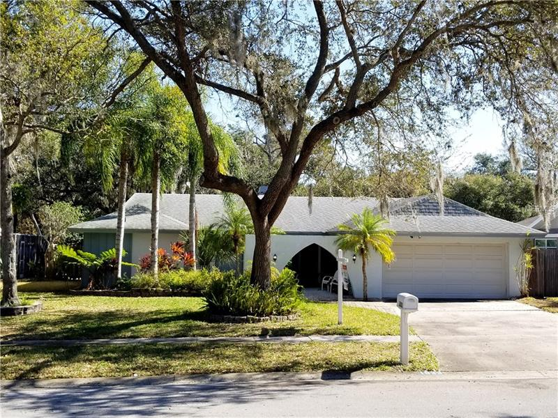 Excellent Location - Close To Downtown Safety Harbor!  Beautiful lot with great curb appeal!  This home has much to offer with just over 2,100 heated square feet.  Featuring four bedrooms, two full bathrooms, a two car garage and plenty of parking space.  Very spacious layout with split bedrooms.  Fourth bedroom would be perfect for an office!  formal living room and family rooms plus dining.  Recently updated kitchen with solid surface counter tops, wood cabinets, and plenty of storage space.  Lots of skylights and sun-tubes throughout!  Living and dining room feature a unique three-sided fireplace and is surrounded by plenty of natural light.  The second and third bedrooms have built-in shelving and desktop.  The screened-in lanai features a decorative wood ceiling with a skylight and is plumbed for a hot tub.  Nice size fenced in backyard with a double-gated entry located on the right side of the home plus a storage shed.  Sprinklers are on reclaimed water!