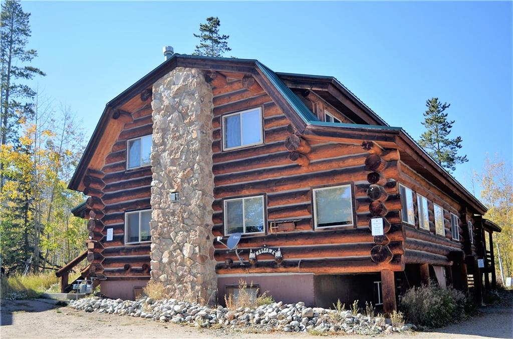 UNIQUE OPPORTUNITY TO OWN TWO DUPLEXES comprising of 12 Bedrooms and 8.5 Bathrooms where you can live, rent and have flexibility of how you want to operate  this property for rental income and/or personal use. True LOG CONSTRUCTION with a mountain cabin feel where hiking trails are out the backdoor. Centrally located to enjoy all that Summit County offers including easy access to 4 Ski Resorts..35 minutes to Vail, CO. Lake Dillon Marina is 10 minutes away...wonderful Golf Courses and much more!