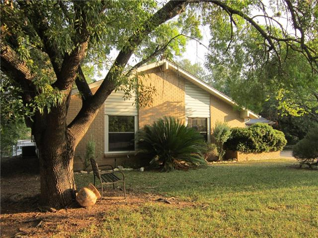 Fixer-Upper Oozing with Potential! Towering Arizona Ash Canopies this 3 Bdrm/2 Bath home on this deep .30 acre, deep lot. Oak, Peach, Plum, Apple & Crape Myrtle Trees border the back & sides.  Covered/Partially enclosed porch-great flex area for plants/relaxing/workout space.  Side Entry Golf Cart Door, Storage Bldg, Organic Garden area. Property extends past back fence. Roof-2009, A/C-2014. Amazing Amenities include:(9) Waterfront Parks, Golf Course, Fitness Center, Lake Privileges, 3 Boat Ramps & More!