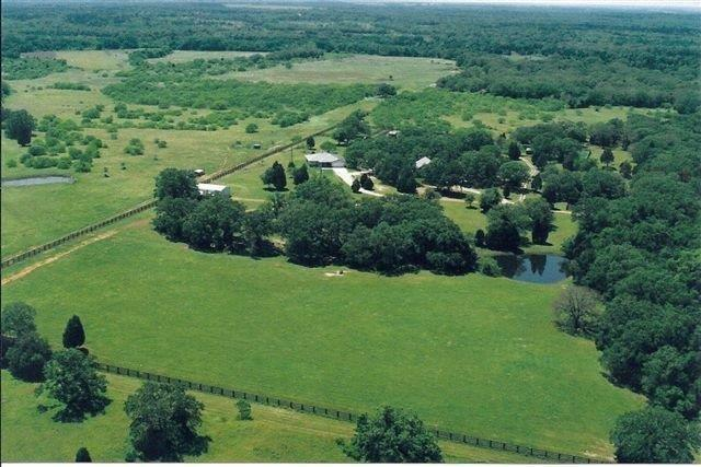36+/- acres of privacy with TWO meticulously maintained homes in Mcdade, TX! Both homes are approx. 1800 sq ft with 2 large bedrooms & 2 baths, both have large covered porches and one with a 2-car garage. Metal 4-stall horse barn, large equipment/hay barn, tractor shed, 3 large horse paddocks with metal loafing sheds, and two stock ponds. Sandy loam soil. Ag exemption. *(Seller will also sell BOTH homes with 15.84 +/- acres separately for $625k.)
