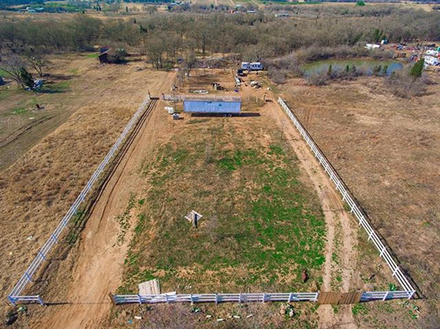 Just a few minutes east of Elgin you'll find this 10+ acre property cleared and ready for a home. It features a 3 way pond system, stocked pond with bass and goldfish, new vinyl fence and a 100 x 120 horse corral. Water lines are already there  and just needs a meter through Aqua. Bluebonnet electric. Build your log home or barndominium or bring in your new modular home. Very close to downtown Elgin with HEB and Walmart.