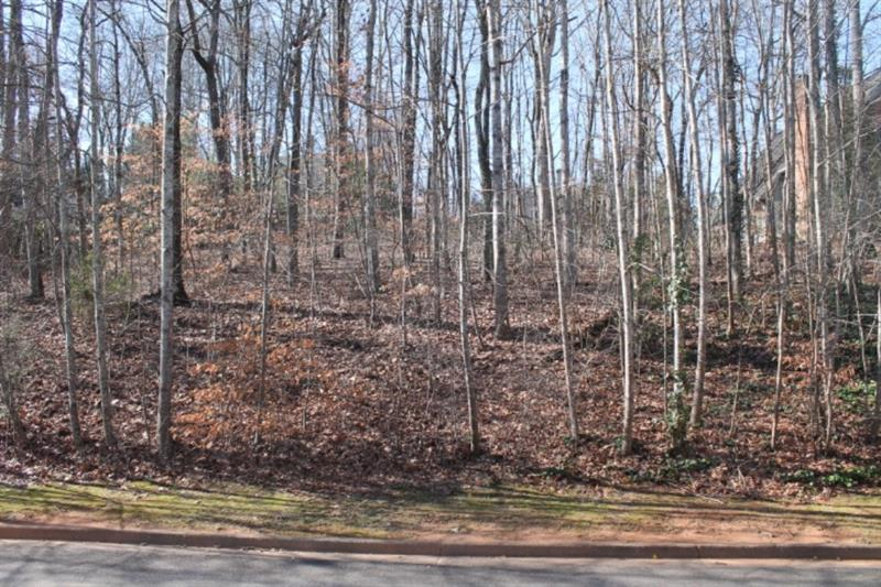 A great lot in desirable Chattahoochee Estates West. Build your dream home on this gently sloped and wooded lot. Minutes from everything you need - Chattahoochee Golf Course, Lake Lanier, Lake Knickerbocker, shopping and schools.