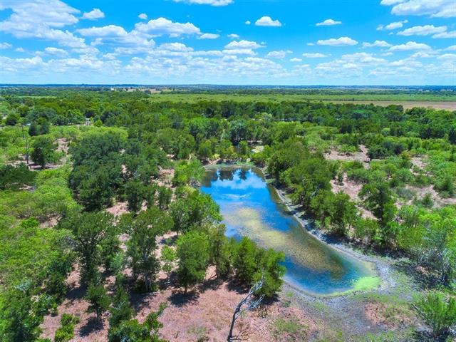 Commercial/Developmental Potential ~ 313.796 acre wooded ranch is in the heart of Cedar Creek, TX & the possibilities are endless. It is rare to find a tract this large on a major road so close to town. The historic 2 story white house on the corner of 21/535 is in poor condition. Please do not access. Sellers are considering moving the house off the property which would open the corner for a great commercial site. Highway 535 & Maja Creek frontage. Listing includes 5.160 acres in Thousand Oaks (Lot 7).