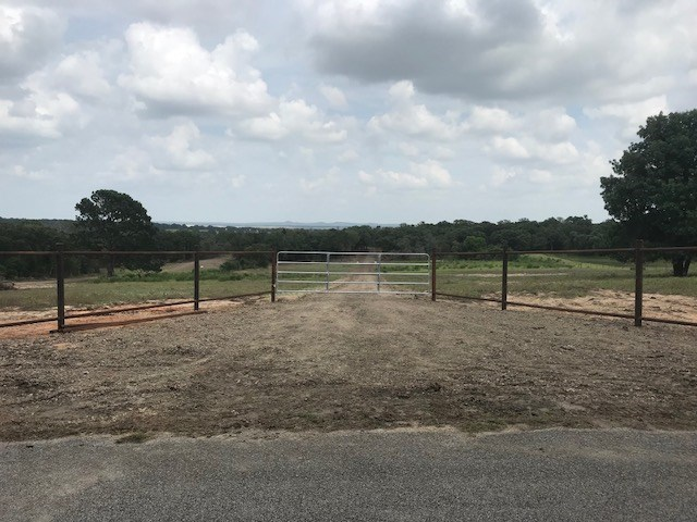 Close to Austin. Part of a larger tract cut in to 3 smaller tracts, all restricted to site built homes only. Barndominiums OK. Nice trees and some open land on this picturesque tract. Nice views from property. Electric and water available. Paved roads all the way to properties