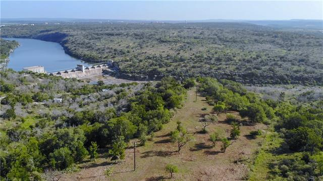 """Beautiful bluff top views of Lake Marble Falls, Max Starcke Dam & the Colorado River all from one amazing build site! Max Starcke Dam Ranch is located less than 5 minutes from Marble Falls. Don't let the convenience fool you. This is a true """"end of the road"""" property with privacy & few rooftops in sight. Sits on the banks of the Colorado River just south of the Max Starcke Dam. Wonderful mix of terrain: open hilltop  giving way to oak lined draws & breathtaking bluffs over the banks of the river."""
