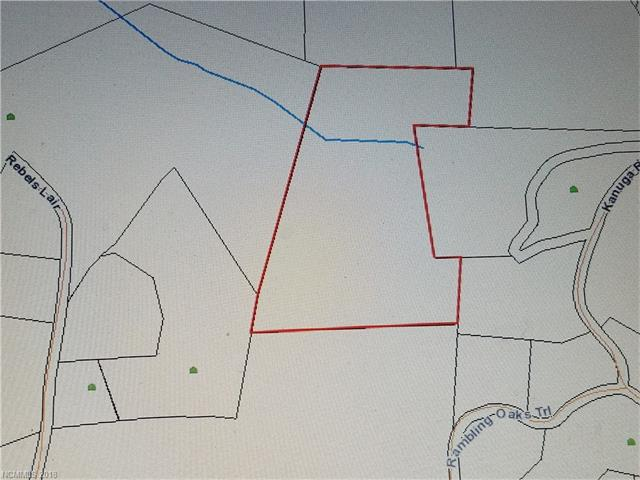 9.41 acres located off Kanuga Ridge.  County zoning R-40 and R2R; Plat map shows possible creek on upper portion.  This acreage is fully treed and we are currently in the process of investigating an easement to accress this property.  The county aerial shows what appears to be a Duke Power easement crossing  the lower left hand corner.   No sign at this time.  Located directly behind 1267 Kanuga Ridge Road.  Please do not attempt to access property.  Call Listing Agent for permission.