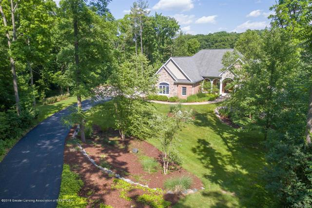 AMAZING OASIS ON THE GRAND RIVER! NESTLED ON ALMOST AN ACRE & A HALF. THIS CUSTOM BUILT APPROXIMATELY 4800 SQ. FT. WALK-OUT RANCH IS PURE PARIDISE a'' FROM THE BRIDGE TO THE EXTENSIVE DOCKING STATION, TO THE INGROUND POOL & CHANGING ROOM, ALL ON A QUIET CUL-DE-SAC IN DELTA TOWNSHIP! THIS MEJESTIC ONE OWNER CUSTOM BUILT HOME HAS AMAZING ATTENTION TO DETAIL THROUGHOUT! STUNNING FOYER ENTRY. BREATH TAKING OPEN FLOOR PLAN. SPECIAL CEILING EFFECTS & FLOOR TO CEILING WINDOWS. BEAUTIFUL FORMAL DINING ROOM INCLUDING SPECIAL ARCHES, PILLARS, & BUILT IN CHINA CABINET. MAIN FLOOR STUDY OFFERING A SPECIAL ARCHED WINDOW, CLOSET, & PRIVATE BATH WITH A STEAM SHOWER (COULD BE A 4TH BEDROOM).