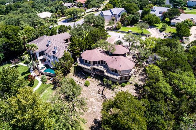 Starting fresh can open up a world of design possibilities. This .56 acre lot on the Pond close to Lakeway Boulevard and minutes from 620 is perfect for a clever concept design to the buyer seeking quality, and natural scenery. This picturesque pond view in LAKEWAY is worth your time and has utilities already in place when going custom.  Adjacent homes 850k+.  Original frame home will be sold as is.  Gentle slope down to the water, plenty of room for a pool perhaps? Need help locating a builder?