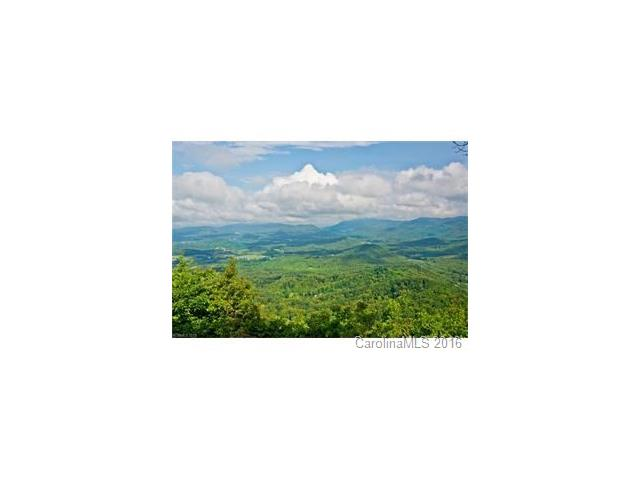 Views! Views! Views! Watch the breath taking sunsets from your new home.  Incredible 180 degree views of Hugh valleys and mountains from Pisgah to Mitchell plus long range views to the Great Smokies.  Driveway cut in and house site cleared and ready for you to build your dream home.