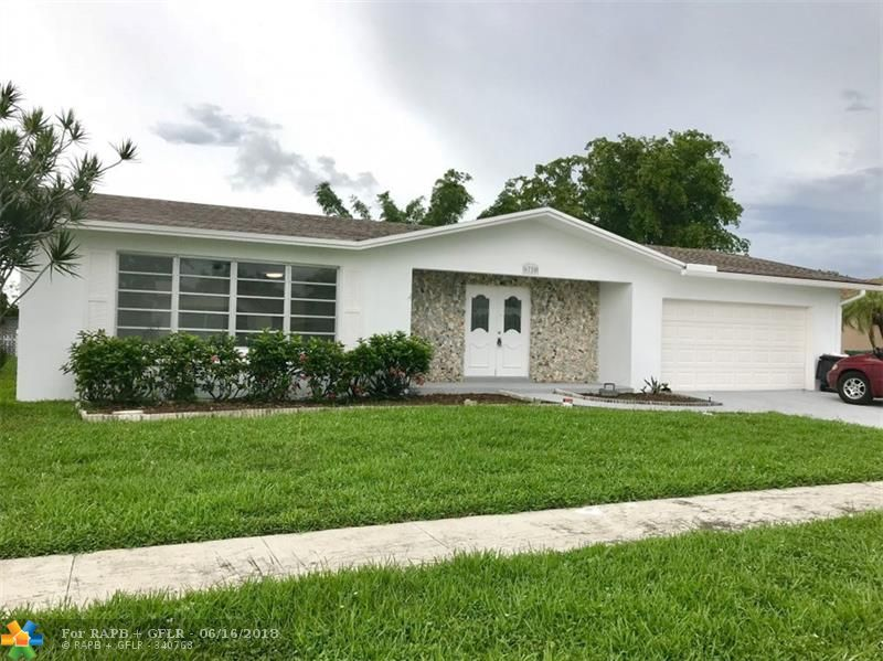 Amazing tastefully renovated spacious 3/2 house with Pool for sale. Tile floors throughout the property, modern cabinets, stainless steel appliances. Great opportunity to own home in excellent neighborhood.