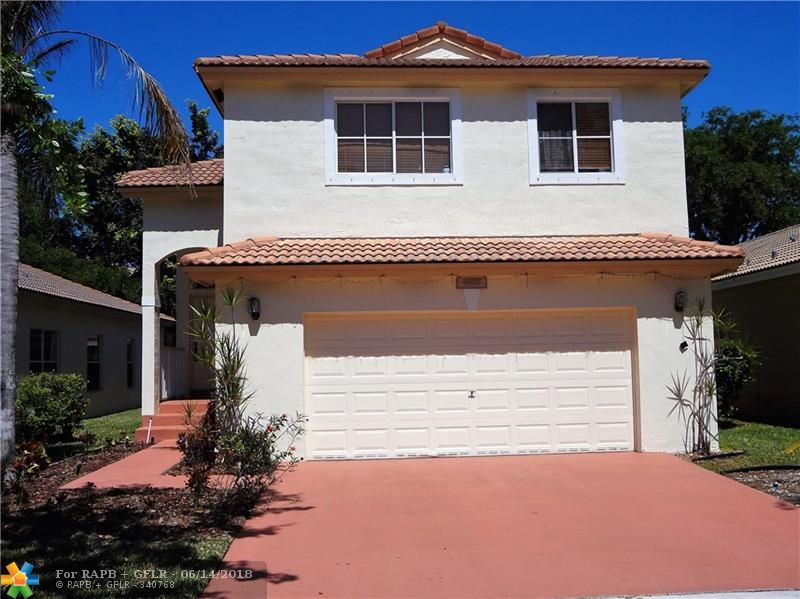 Reduced to go! Spacious 3/2.5 two story in popular, gated Regency Lakes community with clubhouse, pools, tennis & more! This recently painted home features wood & ceramic floors, formal dining room, family room & a large, open living room leading to an expansive screened patio for relaxing or entertaining! The kitchen includes a breakfast area & snack counter & has been updated with new stainless steel appliances. Close to schools, shopping & highways! Don't miss this one!!!
