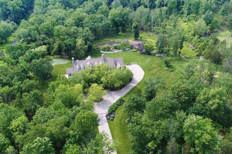 This magnificent property is farm assessed..  2018 Taxes are reduced to $ 25,714 due to tax appeal.  Stone Front Colonial approached by paved circular drive on 7.27, farm assessed, pastoral acres with sun-splashed open floor plan featuring five bedrooms, 5 full and one half bath, built in 1999. Enjoy bucolic countryside views and gardens from covered bluestone porch and rear deck.  Entertainment-friendly living & dining rooms, fireside family room, heart-of-the-home granite and stainless steel center island chef's kitchen. Privately-situated cherry library and home office with separate entry on main floor. Fabulous master suite with sitting room anchored by a gas fireplace, luxury marble master bath. Fully finished daylight lower level offers theater room, wine closet, office, exercise room and full bath. A putting green for all you Golfers! 2018- Gaf Timberline HD roof, 2018 exterior of home re-painted, new well.