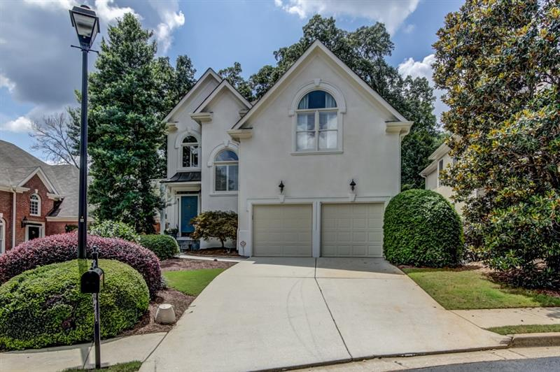 Wow! B'ful Brookhaven home in gated Lenox Cove! Bright & open plan w/ hdwd flrs throughout main. Feat fresh paint, the spacious fam rm boasts gas FP! Kitchen offers tons of cabinet/counter space,s/s Kitchen Aid apps,walk-in pantry,& b'fast rm. Master suite a true retreat w/ his/her closets + add'l walk-in closet(former bdrm). Renovated master bath has dble vanities,jetted tub,& sep shower. Laundry up! Fin terrace lvl w/ bdrm,full bath,& lg liv area. 2 car garage! Lg deck overlooks priv newly hardscpaed b'yard! Great location close to interstates,shopping,& restaurants!