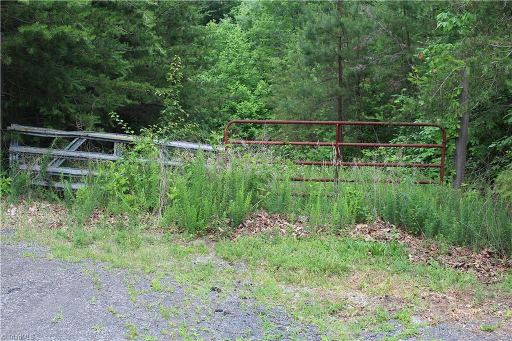 L-1981 Over 2 acres that will feel private yet with the convenience of King or Winston Salem.  Still in West Stokes school district.  Has drive going into land but still is mostly wooded.  Perfect for new home.  Best deal in King!  Land can be accessed off of Hwy 66 from Harris Farm Rd or Crescent dr.  Great Building site near the center back of property. Also joins 10 acre tract for sale.  mls#797366