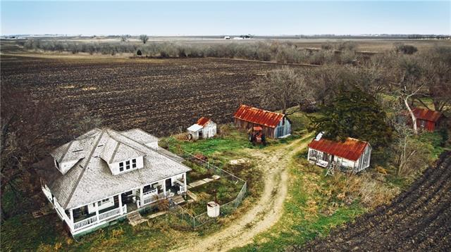 Less than 15 minutes from the 130 Toll Road, right outside of Taylor off of FM 112 158+ acres of quickly disappearing row-crop blackland with an amazing 94 yr. old, 2306 sqft farmhouse, barns, sheds and coops bordered by Brushy Creek.  Featuring broad wrap-a-round porches, a cellar, original wood floors, beadboard, wainscoting, wavy-glass windows, original staircase and a beautiful pine and glass-door passthrough w/screened back. Needs repairs, but def. worth restoring! See attachment for more details.