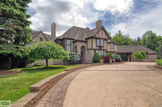 A Rare Find! Custom built 10,000 sq. ft. estate hidden away on private 138 acres in the heart of the Metamora Hunt Club.  Home features all high end finishes & custom woodwork throughout, one-of-a-kind 1 1/2 story with full finished walkout basement that sits approximately 1,500' off road, fantastic views of rolling countryside from walls of windows, large 1st floor owners suite with 4th fireplace walks through to library, 4 upstairs bedrooms & all have private bathrooms, finished walkout features billiards room, wine cellar, exercise room, full bath & recreation area; 4.5-car heated garage, caretakers residence on property along with 40' x 30' pole barn/auxiliary building & pond, 138 acres features rolling meadows & woods with trails, whole house generator system, copper gutters, upper & lower patios overlooking private grounds, original owners have maintained property with true pride of ownership!