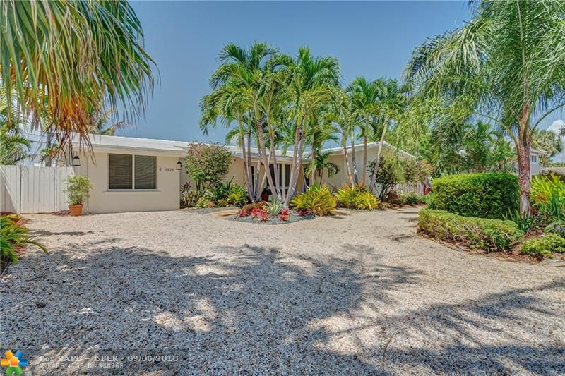 FABULOUS AND FULLY UPDATED CORAL SHORES HOME - A HIDDEN NEIGHBORHOOD IN THE MIDDLE OF EVERYTHING.  3 BEDROOMS 2 BATHROOMS; OPEN LIVING AREA WITH ADDITIONAL FAMILY ROOM;  UPDATED BATHROOMS; GORGEOUS KITCHEN OPEN TO LIVING AREA; ALL IMPACT WINDOWS AND DOORS; ALL MAJOR COMPONENTS OF THE HOME ARE NEWER; BEAUTIFUL SOUTH FLORIDA BACKYARD READY FOR ENTERTAINING OR ENJOYING OUTDOOR LIVING COMPLETE WITH HUGE COVERED LANAI W/ TV AND AN OVERSIZED POOL.   TRULY A MUST SEE AND READY FOR NEW OWNERS.