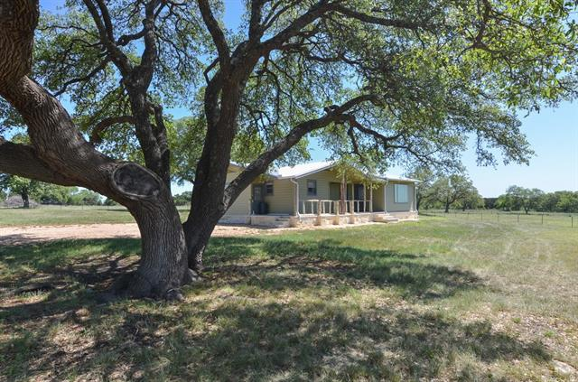 Unique Turn-key Ranch Opportunity!  ~ 90 ag.exempt. gently rolling acres fully fenced & cross-fenced w/abundant wildlife, beautiful native oak&wildflowers ~ planted for hay production (Long Stem Bermuda, Kleingrass & oats in separate fields) ~ water to pens & I-beam barns ~ renovated 1500+sf Ranch home featuring MIL plan, resurfaced wood floors, TREX composite front porch w/native cedar railing, stone accents,  & wi-fi controlable systems (recent, fenced yard,  paint in/out, HVAC system & booster pump)