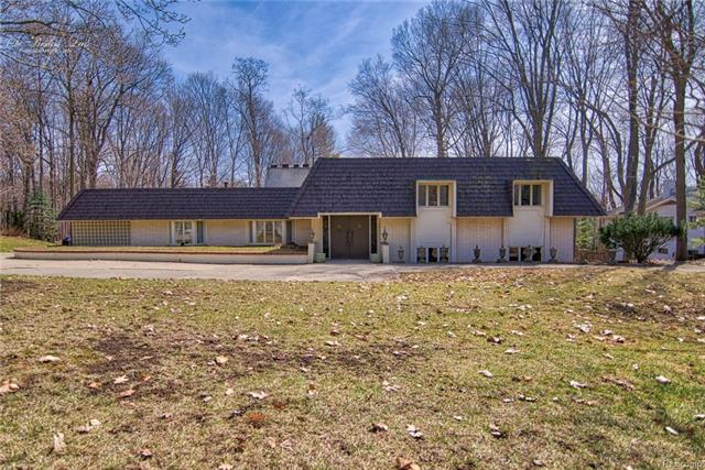 Fantastic Opportunity to own a one- of- a- kind 7 bed 6.5 bath in the heart of Meadowbrook Hills Subdivision. This French Provincial inspired home boats exceptional quality, craftsmanship, and tons of special features that makes this home truly unique: a greenhouse, classroom, library, recreation room, sewing room and tiled workshop.  This house has plaster ceilings and walls throughout, hardwood floors throughout, Anderson Windows throughout,  two fireplaces, crystal chandeliers, plaster crown molding and lots of Italian marble.  Newer roof, AC, and Boiler.  This house is a gem.  You have to see this home to believe it.