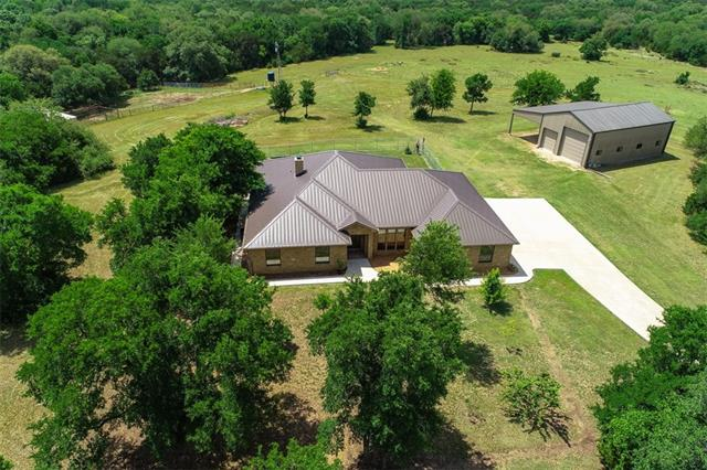 Intriguing 43 acre ranch w/private gated entrance through nice rural subdivision.  Nature surrounds this 2568 sq ft custom home & working ranch. Fruit trees, birds galore, cattle pens and shelter, fenced cross fenced.Traditional 3 bedroom, 3 full bath home, hickory stone exterior w/ standing seam metal roof.  Generous front office of entry, split floor plan, fireplace, inground pool, quartz countertops in kitchen, granite in baths & utility, covered patio, inground pool, 2 wells, huge shop, spring, VIEWS!