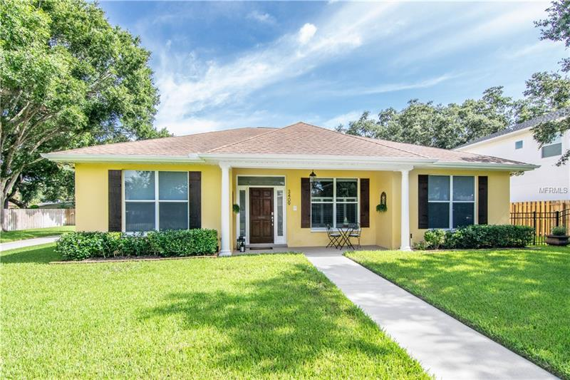 You do not want to miss this Bayshore Beautiful pool home on a rare 110 x 140 lot. This home is surrounded by gorgeous new landscaping in the front and backyard enclosed with a new security gate and electric entry gate. The backyard boasts a custom over sized pool with covered entertainment kitchen and bar, and turfed play area or space for entertaining. There is an over sized 2 car detached garage with workshop and plug in for an electric car as well as gas tankless water heater. An RV height covered car port is next to the garage with full hook up, perfect for an RV or a boat. The home is just over 2000 square feet with a split floor plan and an en suite bathroom in all 3 bedrooms including a half bath easily accessible from the pool. The high ceilings and crown molding provide a light and large open living space with plantation shutters, making this home a perfect indoor and outdoor entertainment home. Conveniently located to shopping, YMCA, restaurants, Bayshore Blvd & MacDill Air Force Base.