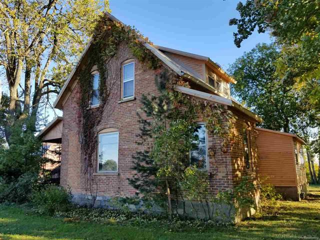 STATELY BRICK FARMHOUSE-located on a paved road midway between Croswell and Lexington. Winery next door & bike path is across the street. Creek runs along the back of the property. Major updating needed, but plenty of space for the family and friends. Covered side porch and large deck off the back of the house. Older Barn included. Michigan and block basement. Additional acreage available to the West.