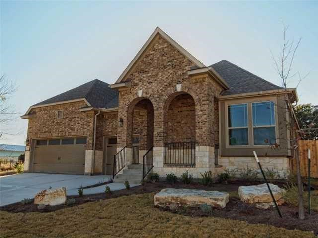 David Weekley's Purdue plan features a 3 car garage and a large covered patio with ceiling fans. The bedrooms