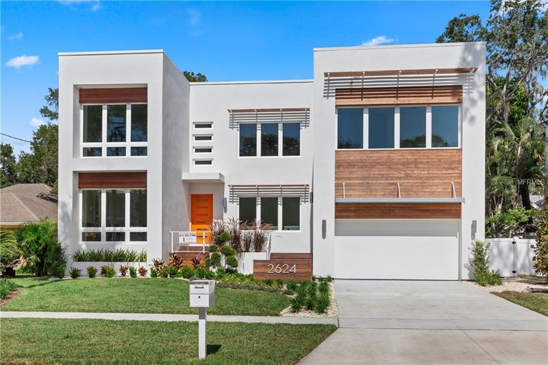 This amazing Sunset Park pool home is not your typical new construction but a unique Modern design that incorporates open spaces and lends itself to entertaining inside and out! The home offers a flexible floor plan with high end contemporary finishes and an open concept that can accommodate various lifestyles. The kitchen is equipped with European style high gloss acrylic and walnut cabinets, JennAir stainless steel appliances, an incredible island w/ Alpha white waterfall quartzite top and a breakfast area all overlooking the pool and lanai. The kitchen shares space with the 2 story great room w/ 21' ceilings w/ a floating stair with bridge and stainless steel cable rails. The home flows perfectly for large parties or intimate get-togethers with a formal dining room with volume ceilings and an abundance of windows. The flexible design on the main floor offers a master suite and an extra flex room plus a downstairs office/in-law suite with a center hall bath. Upstairs features a loft area, 2 bedrooms with a connecting bathroom, an en suite, and a huge media room, gym, or play room! Enjoy Florida living at it's best with a spacious lanai w/ gas fireplace and heated pool and spa all on one level and very private with tons of palm trees surrounding the back yard. Oversized 3 car tandem garage plus storage. Close proximity to Tampa International Airport, International Plaza, restaurants and the beaches!