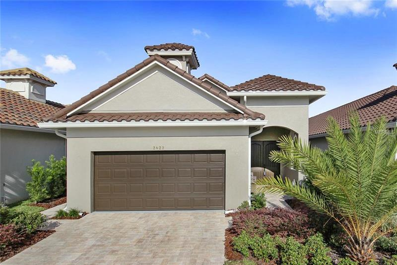Vacation year around-Bring your golf clubs and invest in living well.  This Newton Golf Cottage by ABD Development home sits directly on the golf course with pond and fairway views of the second hole!  Live in the prestigious GUARD GATED Providence community, offering two community resort style pools, rec facility w/ state of the art fitness center, tranquil walking trails plus the championship golf course designed by Michael Dash with an elaborate golf clubhouse, pro shop and restaurant.  Split floor plan with a family room with a beautiful view.  Modern updates include- tile throughout the living spaces, custom tile work in the bathroom, tile backsplash in the kitchen, designer colors and finishes, new refrigerator, new double door entryway, new laundry room shelving and new window treatments.  Enjoy the very best of the Providence lifestyle where nature is your neighbor.  Just a short commute to theme parks, Orlando International Airport, and shopping.  Experience Florida living at its best!